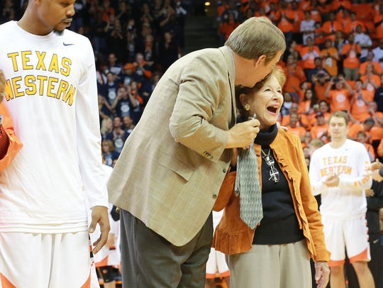 UTEP head basketball coach Tim Floyd kisses Mary Haskins,