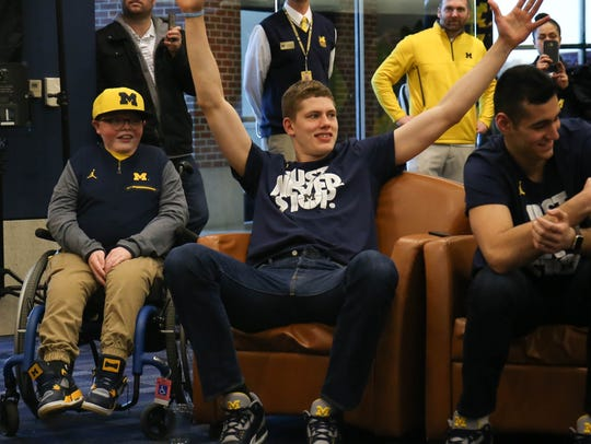 Michigan's Moritz Wagner reacts after finding out Michigan will play Montana in the NCAA tournament.