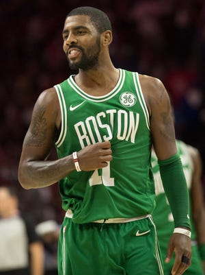 Boston Celtics guard Kyrie Irving (11) reacts after a foul against the Philadelphia 76ers in the closing minutes of the game at Wells Fargo Center.
