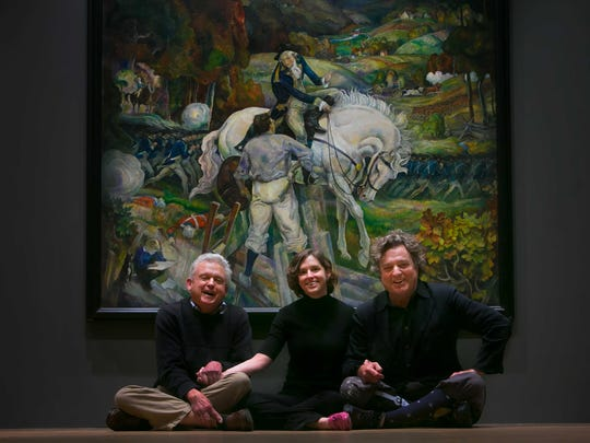 Portrait of Jamie Wyeth (right), his brother Nick Wyeth along with Nick's daughter Victoria as they pose in front of N.C. Wyeth's (1882-1945) painting, 'In a Dream I Meet General Washington', 1930, oil on canvas at the Brandywine River Museum.