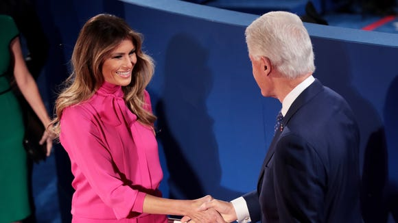 Melania Trump shakes hands with former president Bill