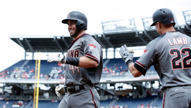 Arizona Diamondbacks' Paul Goldschmidt (44) is congratulated by teammate Jake Lamb (22) after hitting a home run in the ninth inning of a baseball game against the Washington Nationals in Washington, Thursday, May 4, 2017. The Nationals won 4-2.
