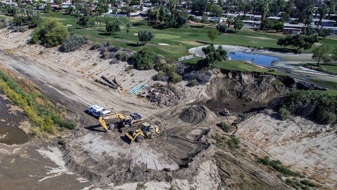 A lake overflowed and eroded a large area of the stormwater channel in Palm Desert, causing multiple pipes to break.