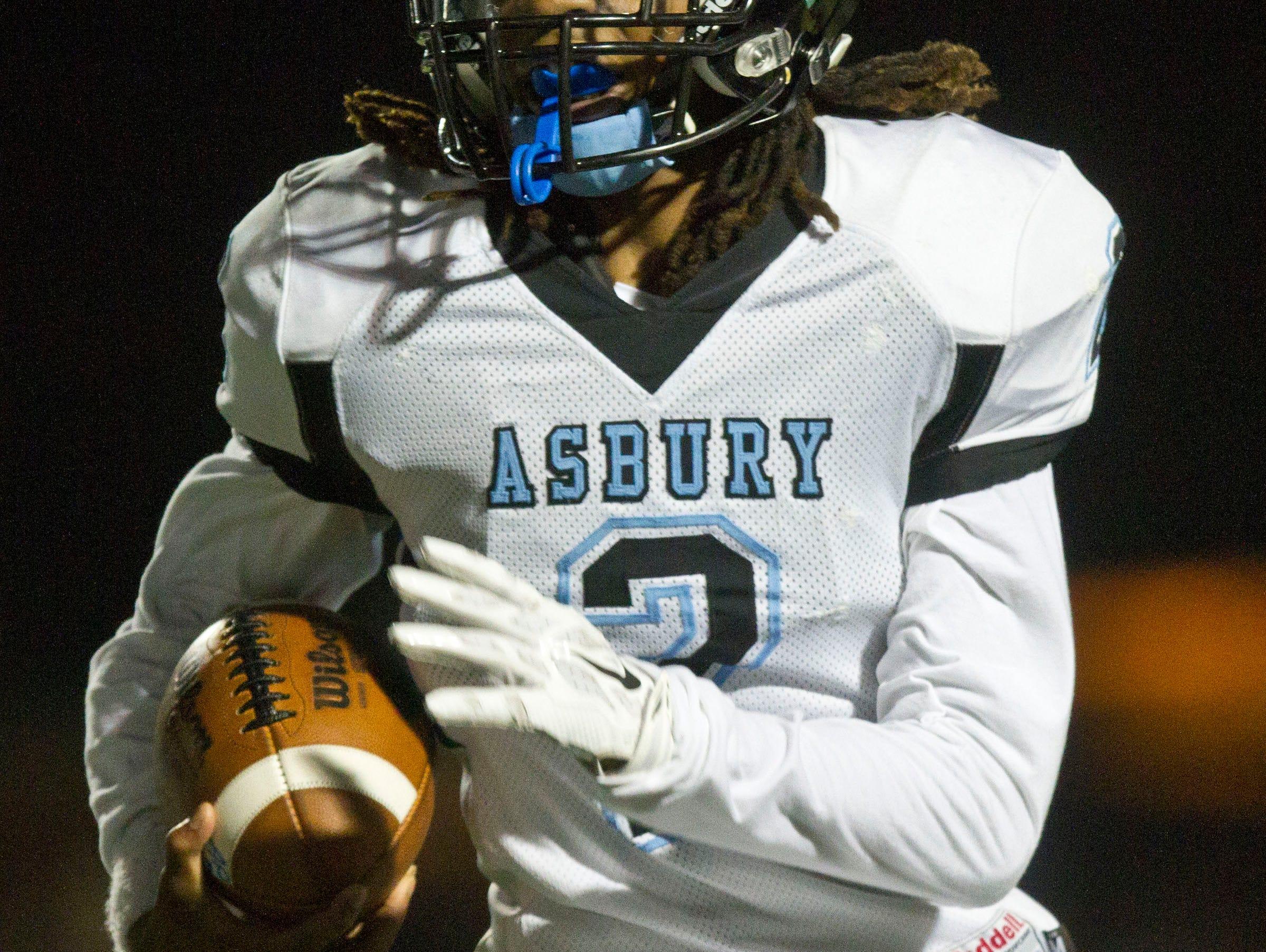 Asbury Park's Tyreek Mccain gains yards on the ground. Asbury Park vs Shore Regional football. Asbury Park, NJ Freiday, November 6, 2015 @dhoodhood