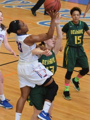 Louisiana College's RyDeja McQuarn (33, left) goes for two against Belhaven's Candler Gregory (13, right) Saturday.