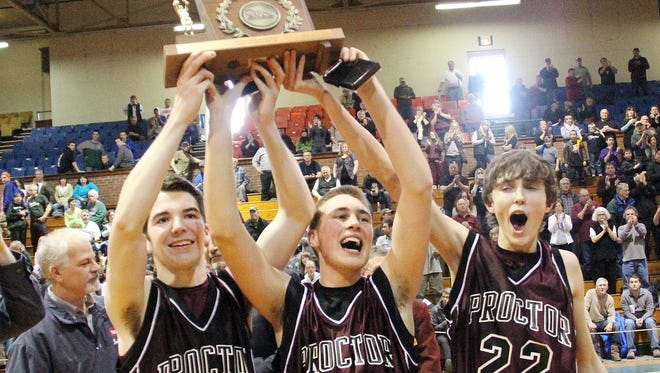 Members of the Proctor High School boys basketball team celebrate the Phantoms' 15th Division IV state championship at Barre Auditorium on Saturday.