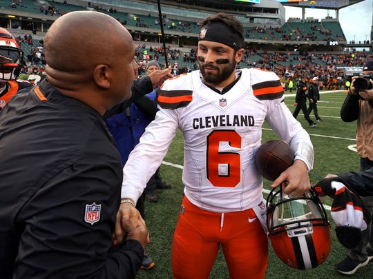 Nov 25, 2018; Cincinnati, OH, USA; Cincinnati Bengals special assistant to the head coach Hue Jackson (left) meets with Cleveland Browns quarterback Baker Mayfield (6) after their game at Paul Brown Stadium. Mandatory Credit: Aaron Doster-USA TODAY Sports