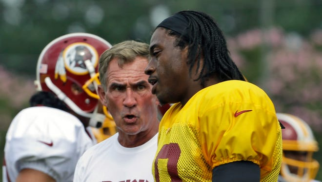 It didn't always appear that Redskins coach Mike Shanahan and Robert Griffin III were on the same page this summer regarding the quarterback's playing status.