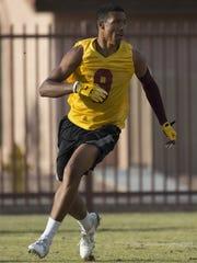 Phoenix Mountain Pointe's Isaiah Pola-Mao runs drills during practice at Mountain Pointe High School on April 29, 2016 in Phoenix.