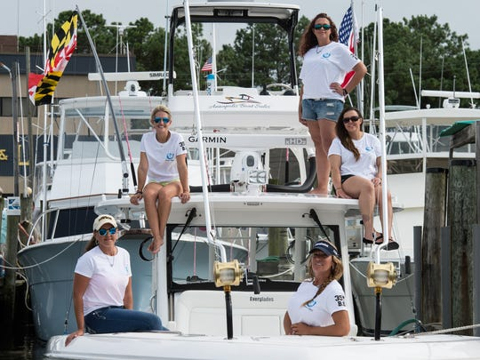 From left, members of the Women's Offshore Alliance Lisa Foxwell, Nikki George, Jamie Buffington, Shannon Ehinger, and Chris Tina Olivieri-Dupuis pose for a photo at the O.C. Fisherman's Marina in West Ocean City on Tuesday, Aug. 8, 2017.