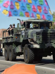 A military vehicle carries several grand marshal veterans during Saturday's  Moorpark Country Days parade.