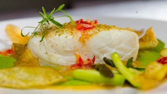 Alaskan halibut with pea puree, asparagus, pickled pepper and fingerling potato at Third Coast Provisions, 724 N. Milwaukee St.