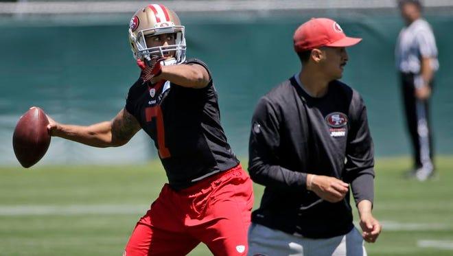San Francisco quarterback Colin Kaepernick throws during an organized team activity Tuesday in Santa Clara, Calif.
