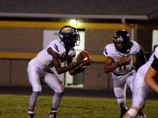 Northeast's Quinton Cross (Left) scored two touchdowns