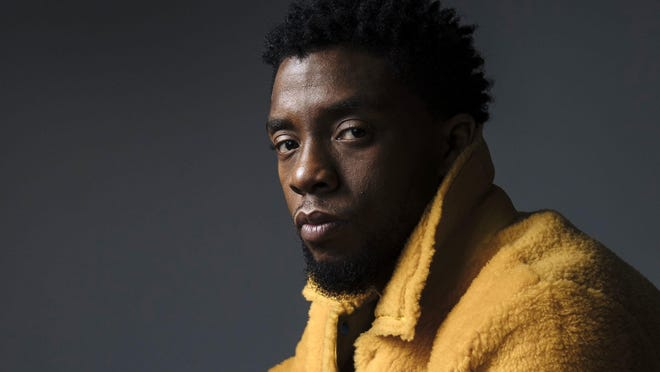 """In this Feb. 14, 2018 photo, actor Chadwick Boseman poses for a portrait in New York to promote his film, """"Black Panther."""""""
