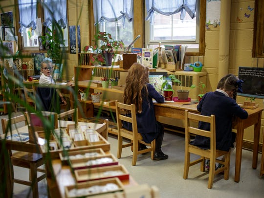 Students work on a lesson in a montessori kindergarten class Friday, Oct. 21, 2016 at St. Mary's Catholic School in St. Clair. The school is celebrating its 110th anniversary.