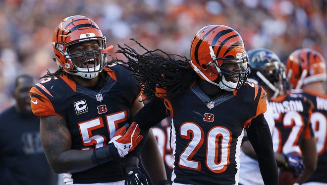 Bengals free safety Reggie Nelson (20) and outside linebacker Vontaze Burfict celebrate after a third-down stop in the 3rd quarter.