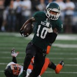 Trinity's Rodjay Burns (10) gains yardage against Cocoa on Friday at Trinity High School. (By David Lee Hartlage, Special to the C-J) Sept. 19, 2014.