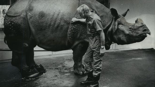 A rhino isn't normally known for being sociable, but Rudra and Glenn E. Downing, his veterinarian at the Milwaukee County Zoo, get along famously. This photo was first published in the Dec. 18, 1975, Milwaukee Journal Green Sheet.