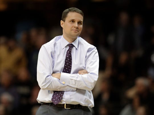 "FILE - In this Jan. 20, 2018, file photo, LSU coach Will Wade watches from the sideline during the second half of the team's NCAA college basketball game against Vanderbilt in Nashville, Tenn. LSU officials say their first meeting with suspended coach Wade has taken place but that there is not yet a resolution regarding Wade's long-term status. A written statement from the university says ""it is unlikely LSU makes any decisions today regarding Coach Wade."" (AP Photo/Mark Humphrey, File)"