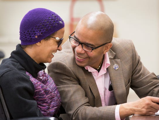 Christopher and Pamela share a moment as Pamela votes at the Board of Elections in Norwood.