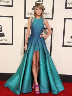 Taylor Swift arrives at the 57th annual Grammy Awards at the Staples Center in Los Angeles.