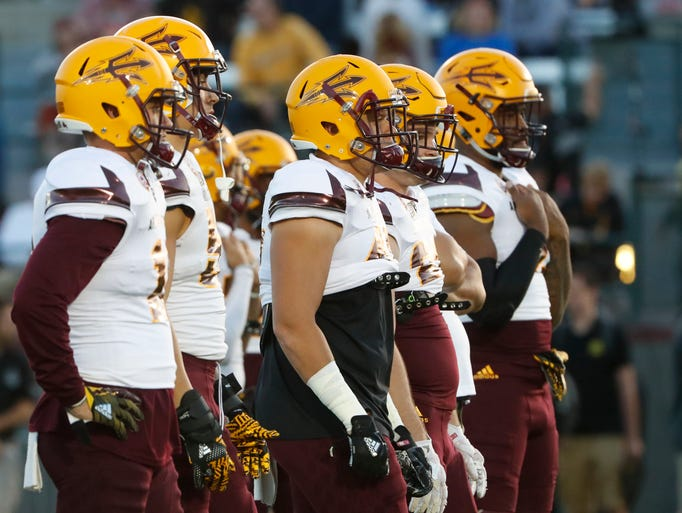 ASU's defense lines up for drills during the spring
