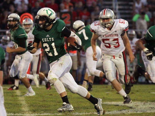 Clear Fork's Sloan Bowman runs the ball into the Fredericktown defense during the first home game of the season in the valley.