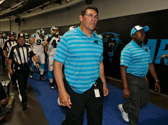 "FILE - In this Aug. 8, 2014, file photo, Carolina Panthers head coach Ron Rivera leads his team from the locker room before a preseason NFL football game against the Buffalo Bills in Charlotte, N.C. Gone are the days when NFL locker rooms were a players-only domain. More coaches are making their presence felt in a place they weren't always welcomed. ""That locker room is our locker room,"" Rivera said. ""I have a vested interest in the locker room.""  (AP Photo/Chuck Burton, File)"