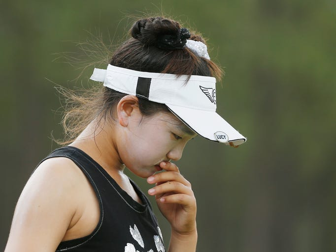 Lucy Li, fighting to make the cut in the U.S. Women's Open, walks off the eighth tee.
