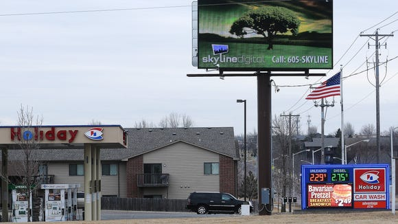 An electronic billboard at the corner of 41st Street and Sycamore Avenue.