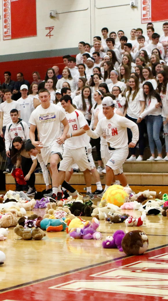 Fans throw teddy bears on the court after the first