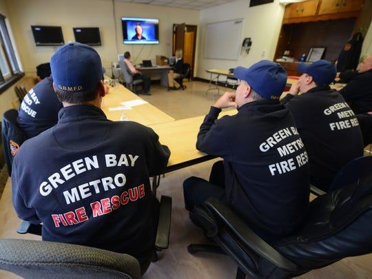 Green Bay Metro Fire Department personnel from various