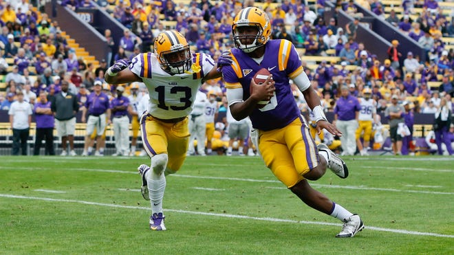 LSU quarterback Brandon Harris (right) runs for a touchdown past cornerback Dwayne Thomas during the spring game in April. Miles is seeing improvement in Harris.
