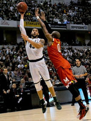 Michigan State senior guard Denzel Valentine (45) goes up for a shot over Maryland senior guard Rasheed Sulaimon (0) during the first half of MSU's Big Ten Tournament semifinal game against Maryland, Saturday, March, 12, 2016 at Bankers Life Fieldhouse in Indianapolis.