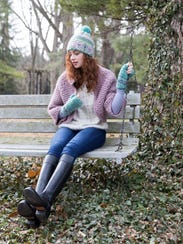 A model wearing the Cordova boot and winter accessories