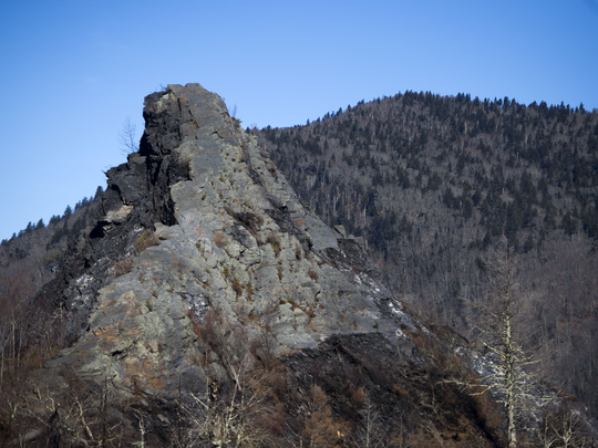 Severe burn damage is visible on a rock face at the summit of Chimney Tops trail Thursday, Feb. 16, 2017. The trail, which is the site of the wildfires' beginning, is closed to the public due to damage and will remain closed through 2017.