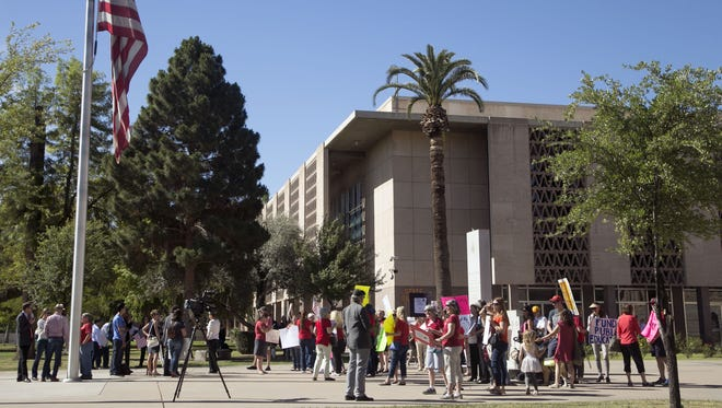 Protesters demonstrate against the school-voucher expansion at the Arizona State Capitol in Phoenix on April 6, 2017.