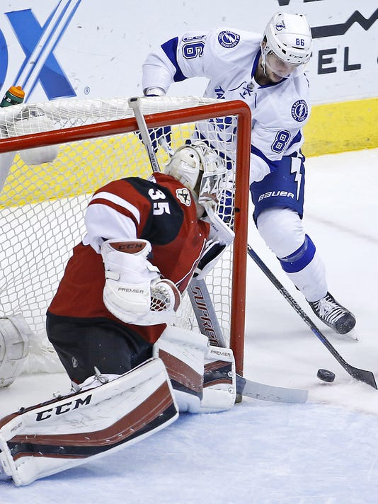 Arizona Coyotes goalie Louis Domingue (35) makes a save on Tampa Bay Lightning right wing Nikita Kucherov (86) during the first period  of an NHL hockey game Saturday, March 19, 2016, in Glendale, Ariz. (David Kadlubowski  /The Arizona Republic via AP) MARICOPA COUNTY OUT; MAGAZINES OUT; NO SALES; MANDATORY CREDIT