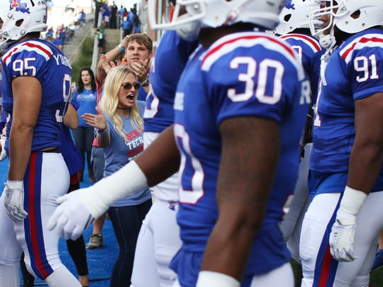 A Louisiana Tech fan greets players as they enter the field before a game against the University of North Texas at Joe Aillet Stadium in Ruston, La., Saturday, Nov. 4, 2017.