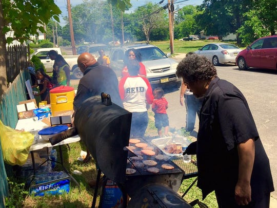 Friends and family celebrate Jerame C. Reid's birthday with an outdoors barbeque Sunday in Bridgeton.