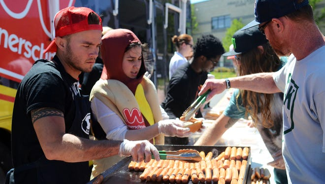 Josh Schmitz, executive director for Skate For Change, cooks hot dogs during the Hot Dogs For Homeless tour Wednesday afternoon at Bishop Manogue Catholic High School in south Reno.