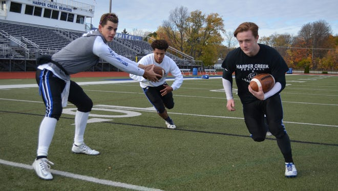 Harper Creek uses a diverse offensive attack with, from left, dual-threat quarterback Jackson Malone, Jalonty Hervey and Noah Bauserman all playing a key role.