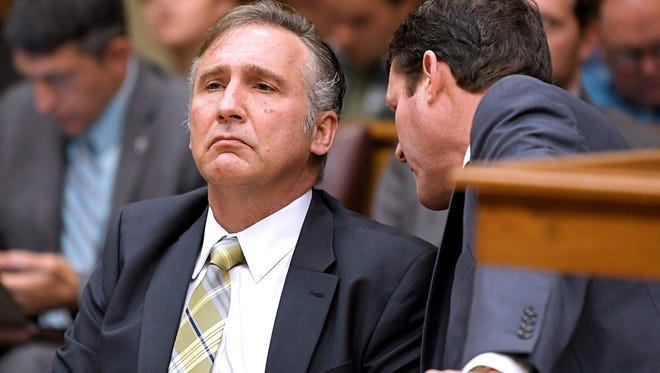 Williamson County Schools Superintendent Mike Looney listens to his attorney Mark Puryear during a hearing Wednesday, April 25, 2018. A judge dismissed assault charges against Looney.