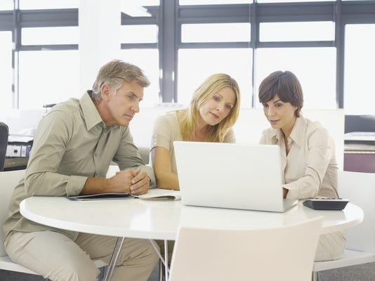 mature-couple-with-financial-advisor-looking-at-laptop_large.jpg