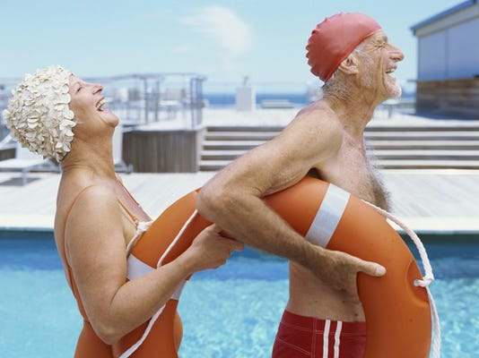 retiree-seniors-couple-swiming-with-life-ring_large.jpg