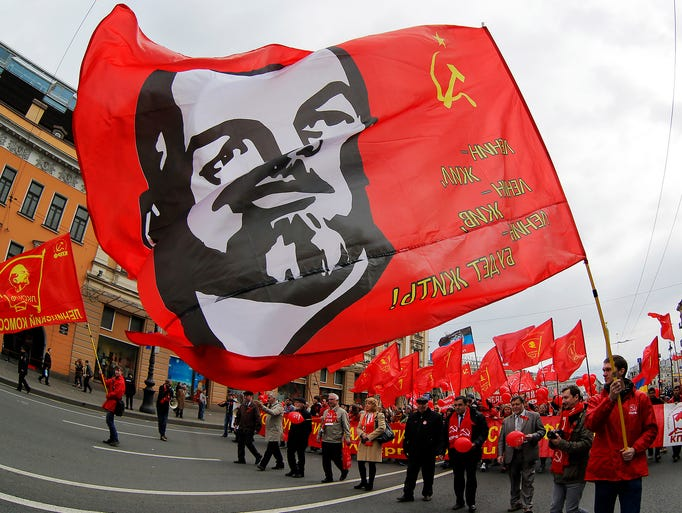 Communists wave a flag with the image of Vladimir Lenin, the founder of the former Soviet Union, during a traditional May Day march in St. Petersburg, Russia.
