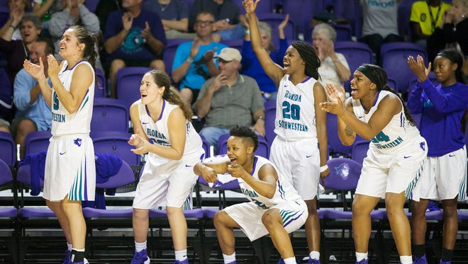 Florida SouthWestern State College basketball players celebrate scoring against Hillsborough Community College on Tuesday, Nov. 29, 2016 at FSW in  Fort Myers. FSW beat Hillsborough 80-64.