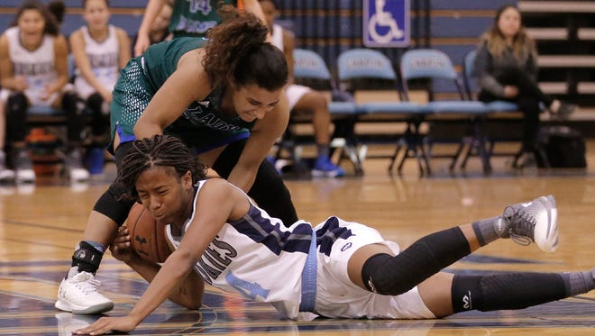 Chapin's Morgan Herbert dives into Montwood's Jordan Maxwell as they go for a loose ball Tuesday night at Chapin High School.