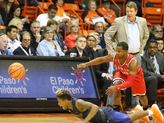 UTEP's Evan Gilyard, bottom, dives for a loose ball